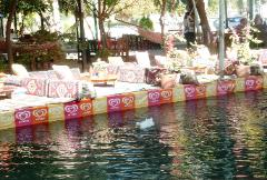 Ottoman seating at stream-side restaurants in Saklikent Gorge